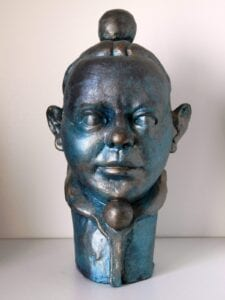 CABEZA DE MALABARTISTA. Arqueológicas en Escultura